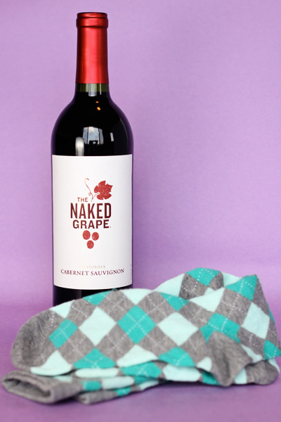 Gift wrap a wine bottle with a pair of cute knee socks for Cute wine bottles