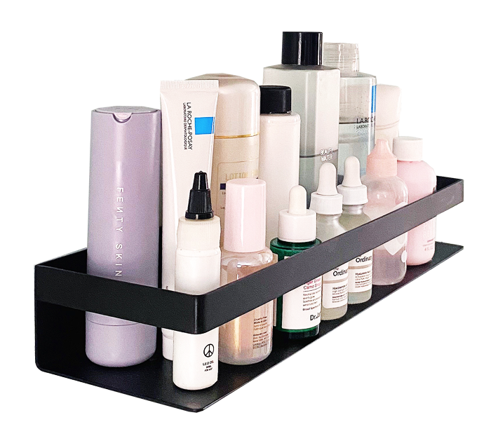 A black bathroom shelf filled with skincare products